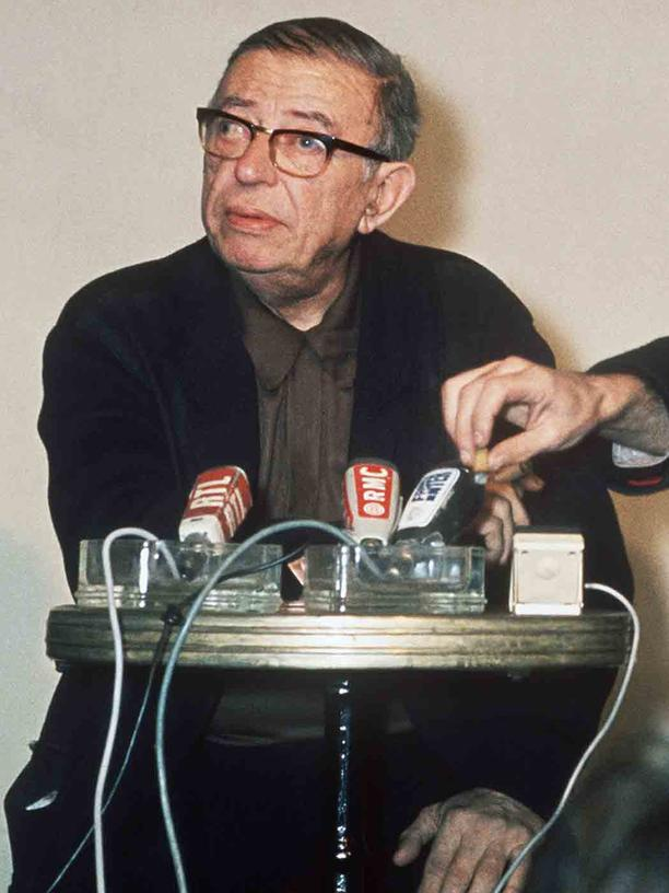 "Rassismus: French existentialist philosopher and writer Jean-Paul Sartre (L,1905-80) and French film director Jean-Luc Godard, one of the leaders of French ""nouvelle vague"" cinema, answer the media in February 1971 in Paris. In 1945, Sartre emerged as the leading light of the left-bank intellectual life of Paris. (Photo credit should read /AFP/Getty Images)"