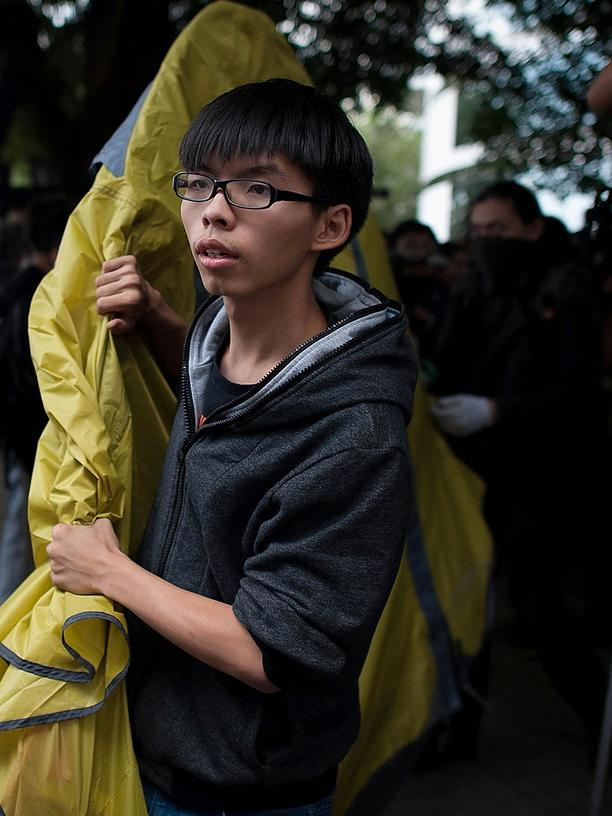 Joshua Wong: HONG KONG - NOVEMBER 18:  Joshua Wong (L) relocates a tent on a street outside of Citic Tower on November 18, 2014 in Hong Kong. bailiffs oversaw the removal of some barricades blocking access to Citic Tower after an injunction was requested by the owners. Hong Kong's high court has authorized police to arrest protesters who obstruct bailiffs on the three interim restraining orders.The court order comes as democracy protests enter their eighth week.  (Photo by Anthony Kwan/Getty Images)  HONG KONG, HONG KONG - JUNE 17: Pro-democracy activist Joshua Wong speaks to the media outside the Legislative Council shortly after being released from prison on June 17, 2019 in Hong Kong, Hong Kong. Hong Kong pro-democracy activist, Joshua Wong, said on Monday after being released from jail that Chief Executive Carrie Lam must step down as he joined protesters against the controversial extradition bill which would allow suspected criminals to be sent to the mainland and place its citizens at risk of extradition to China. (Photo by Carl Court/Getty Images)