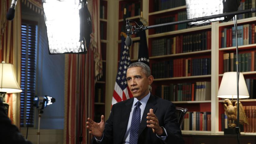 Überwachung: Barack Obama im Reuters-Interview. Wie groß soll die Hintertür zu den Daten von Google und Apple sein? So groß ...?