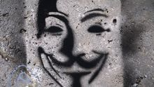 Graffito einer Guy-Fawkes-Maske, dem Symbol der Anonymous-Bewegung