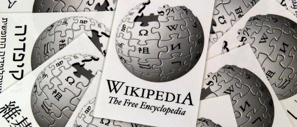 Logo der Wikipedia. Zum 14. Geburtstag sinkt die Zahl der Autoren weiter