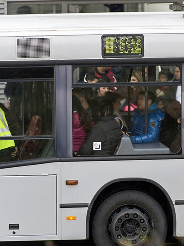 Rejected asylum applicants climb aboard an airport bus to be brought to a charter flight.