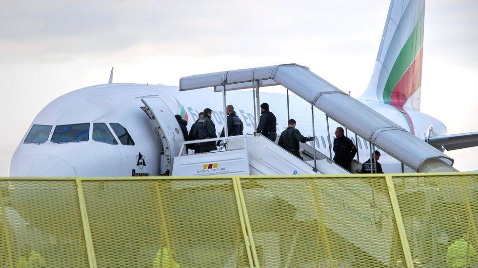 Refugees in Germany: Deportees boarding a charter flight at the edge of the airfield.