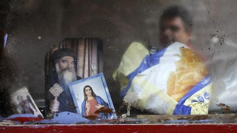 Christenverfolgung: Ein Schaufenster in Kairo zeigt Bilder von Jesus und Shenouda III. von Alexandrien, dem Oberhaupt der Koptischen Kirche