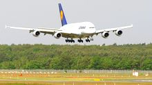 BERLIN, GERMANY - MAY 22: A Lufthansa Airbus A380 airplane lands prior to its christening with the name 'Berlin' at Tegel airport on May 22, 2012 in Berlin, Germany. The christening of the Airbus A380, the largest commercial passenger airplane, comes amidst controversy surrounding the new Willy Brandt Berlin Brandenburg International airport, still under construction. The new airport, to replace the area's current two hubs, Schoenefeld and Tegel airports, was expected to begin operation on June 3. However, due to complications with the fire safety system, the opening has been rescheduled to March 2013. (Photo by Adam Berry/Getty Images)