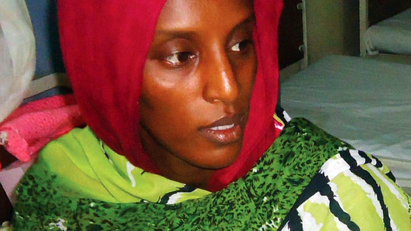 Khartum : Meriam Yahia Ibrahim Ishag, a 27-year-old Christian Sudanese woman sentenced to hang for apostasy, sits in her cell a day after she gave birth to a baby girl at a women's prison in Khartoum's twin city of Omdurman on May 28, 2014. Sudan denied on June 1, 2014 Ishag would be freed soon, saying quotes attributed to a foreign ministry official had been taken out of context. AFP PHOTO / STR (Photo credit should read -/AFP/Getty Images)