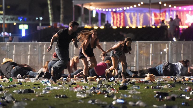 Las Vegas: Besucher des Festivals in Las Vegas rennen vom Gelände, nachdem Schüsse gefallen sind.