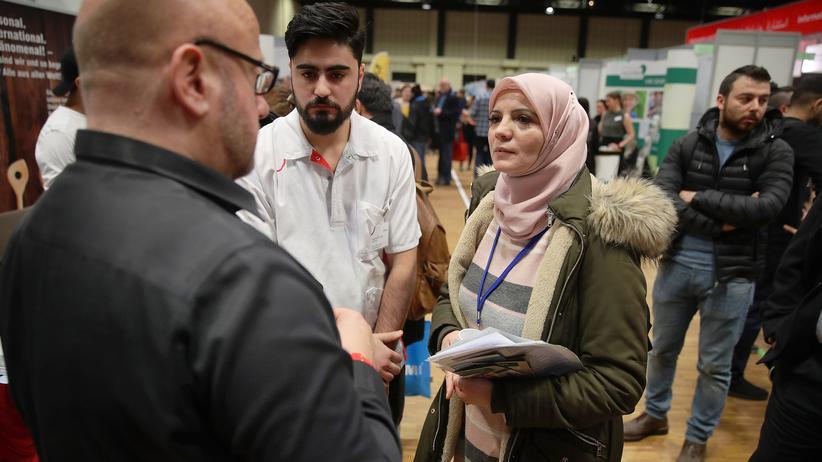 Migration: Syrer auf einer Jobmesse in Berlin