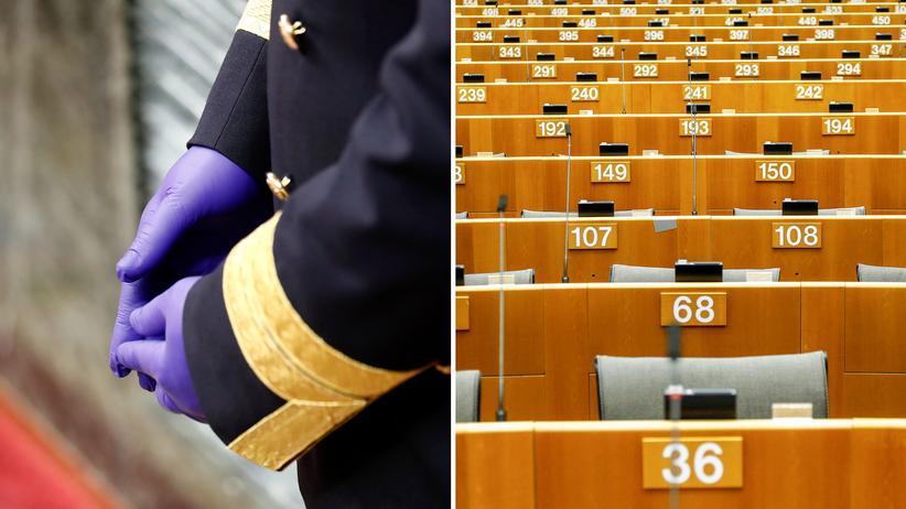 Auswirkungen der Pandemie: Saaldiener im Parlament in Madrid, Europaparlament in Brüssel