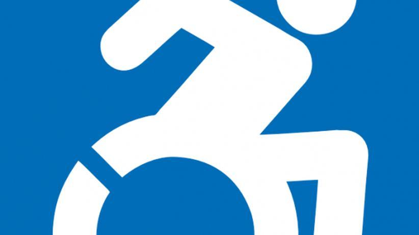 Piktogramm: Rollstuhlfahrer in voller Fahrt
