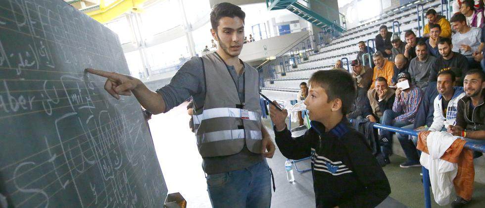 Flüchtlinge Helfer