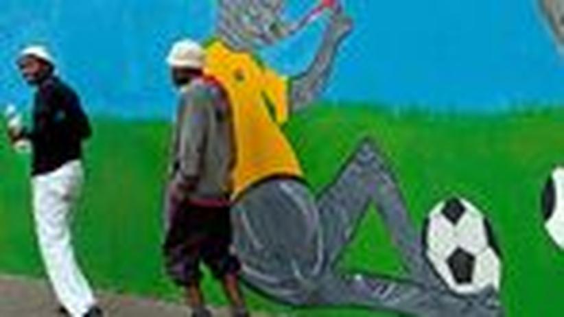 Theater in Afrika: Prügel unterm Regenbogen