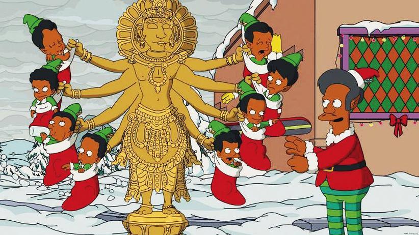 """""""Die Simpsons"""": Ist das schon Rassismus? Apu feiert Weihnachten: Wie es das Klischee will, mit vielen Kindern und einer Statue der achtarmigen Göttin Shiva."""