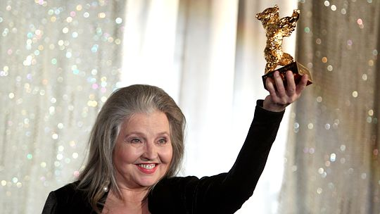 BERLIN - FEBRUARY 18: Actress Hanna Schygulla holds up her Honorary Golden Bear for lifetime achievement she received at the 60th Berlinale International Film Festival at Kino International on February 18, 2010 in Berlin, Germany. (Photo by Sean Gallup/Getty Images)
