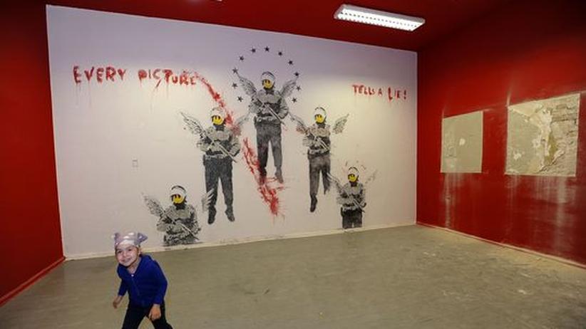 Street Art: Banksy-Bild in Berlin freigelegt