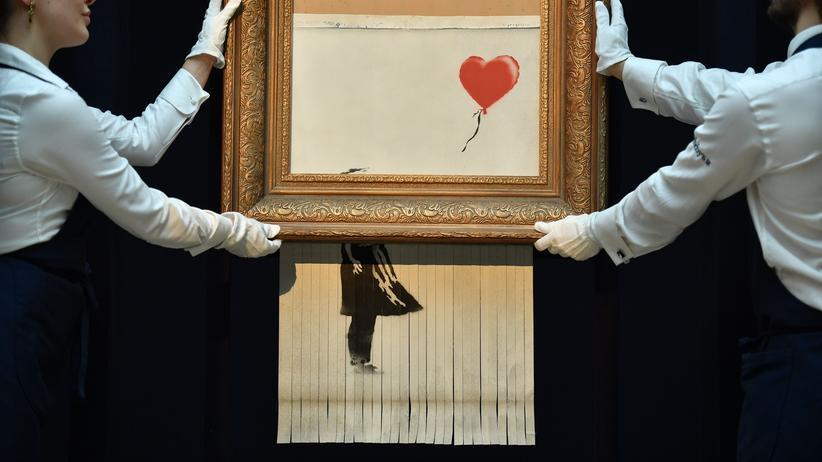 Sotheby's: Banksy wollte Kunstwerk bei Auktion komplett schreddern
