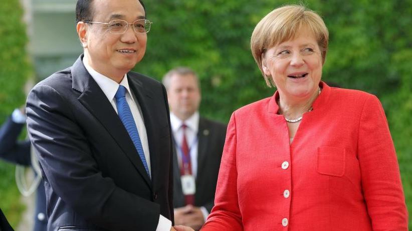 Zollstreit: Merkel und Li beraten: Trump wettert aus Washington