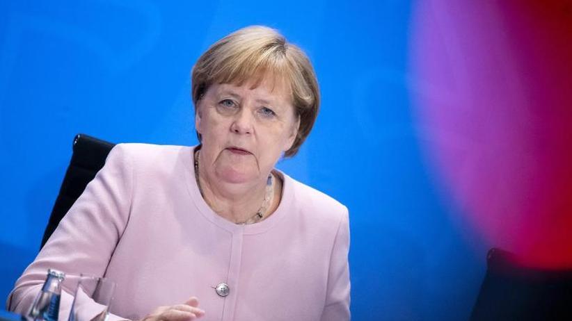 Auch Macron vor Ort: Merkel will in Genf Sozialstandards anmahnen