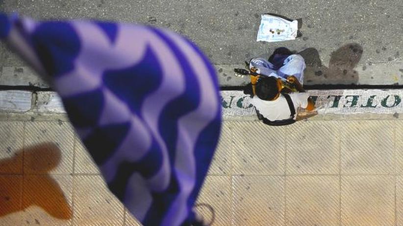 Ein junger Bettler in Athen