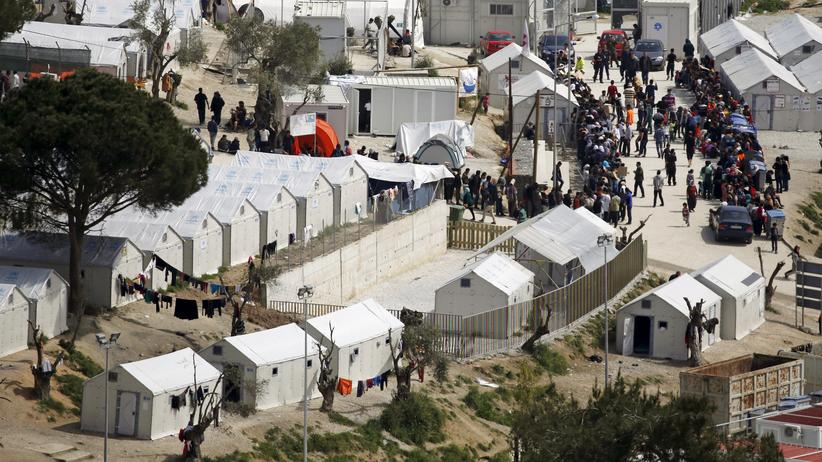Lesbos: Refugees and migrants make their way in the Moria registration centre on the Greek island of Lesbos, April 3, 2016.
