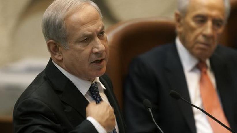 Nahostkonflikt: Israels Ministerpräsident Benjamin Netanjahu (l.) vor dem israelischen Parlament, der Knesset