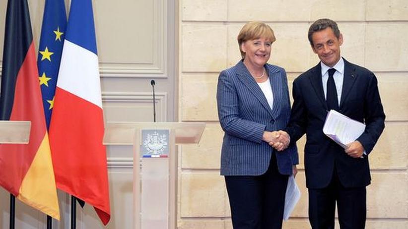 Merkel und Sarkozy: Kritik an deutsch-französischen Wirtschaftsplänen