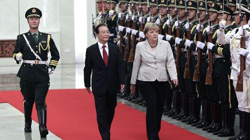Peking-Reise: Merkel verlangt von China Pressefreiheit