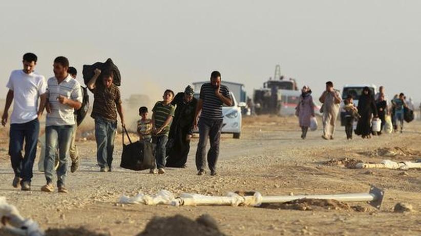 Syrische Flüchtlinge auf dem Weg in ein jordanisches Flüchtlingslager