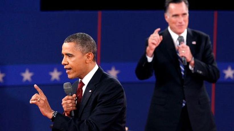 TV-Duell: US-Präsident Obama (v.) und sein Herausforderer Mitt Romney