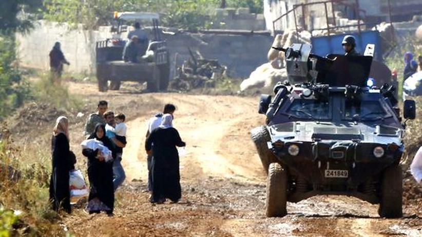 Türkisches Militär und syrische Flüchtlinge