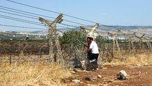 Syrer passieren die Grenze zur Türkei.