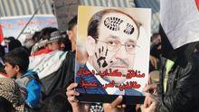 Gegner von Iraks Regierungschef al-Maliki bezeichnen ihn bei einer Demonstration Anfang Januar auf diesem Plakat als Lügner, Dieb und Kolloborateur.