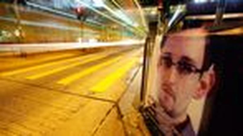 Whistleblower: Ein Poster mit dem Bild Edward Snowdens in Hongkong