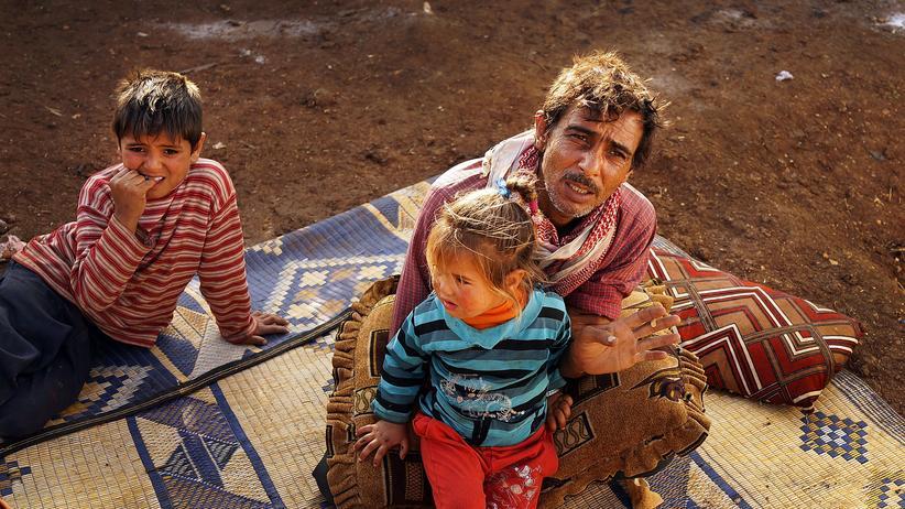 Bürgerkriegsflüchtlinge: Eine Familie aus der belagerten syrischen Stadt Aleppo im Flüchtlingslager im Libanon