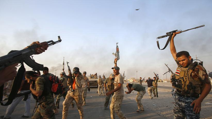 Geopolitics: Iraqi Shiite militia fighters fire their weapons as they celebrate breaking a long siege of Amerli by Islamic State militants.