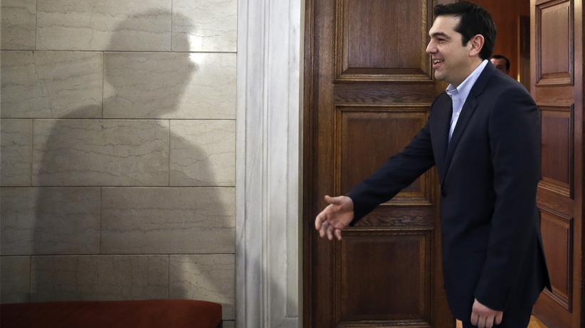 Der Schatten von Eurogruppenchef Jeroen Dijsselbloem (l.) und Griechenlands neuer Regierungschef Alexis Tsipras