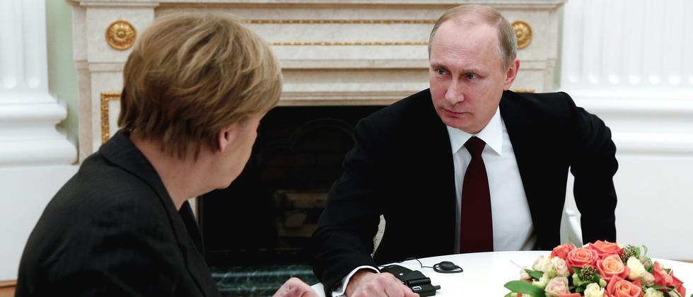 Russlands Präsident Wladimir Putin und Kanzlerin Angela Merkel bei einem Treffen am vergangenen Sonntag