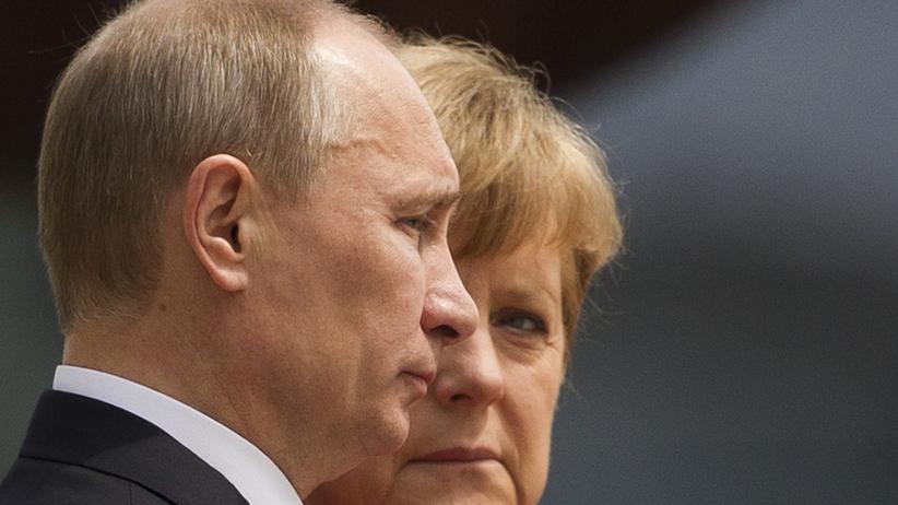 Ukraine-Krieg: Russlands Präsident Wladimir Putin und Kanzlerin Angela Merkel