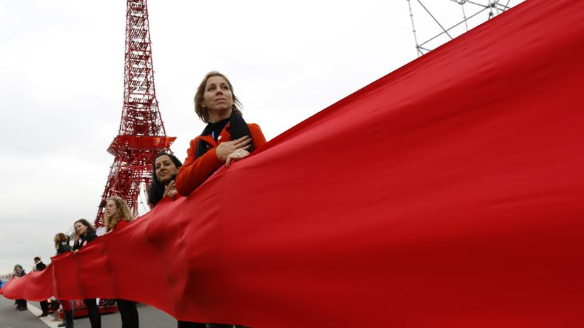 Paris: Women take part in a giant red line demonstration as an act of climate disobedience from the COP21 Eiffel Tower replica down the Champs Elysee corridor during the World Climate Change Conference 2015 (COP21) in Le Bourget, near Paris, France, December 11, 2015.