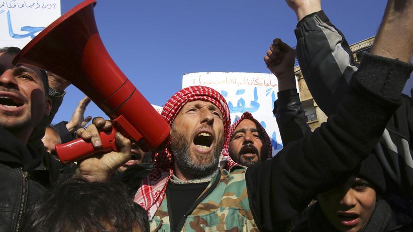 Syrien: Rebellen und Anwohner demonstrieren in Damaskus für die Freilassung politischer Gefangener.