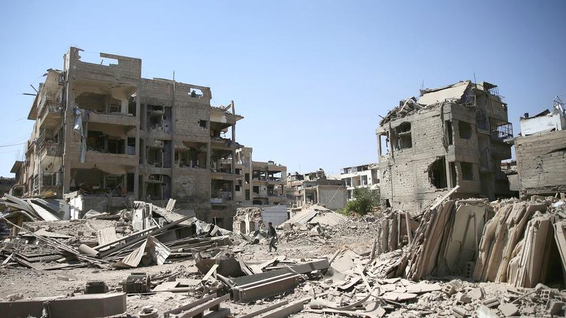 Bürgerkrieg in Syrien: Ein von Rebellen kontrollierter Teil von Damaskus nach einem Luftangriff