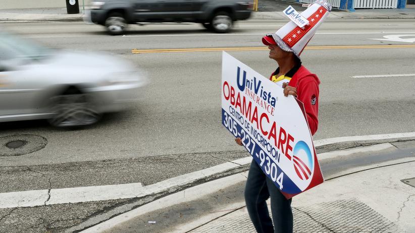 Gesundheitsreform: Ein Mann macht Werbung für eine Obamacare-Versicherung in Miami.