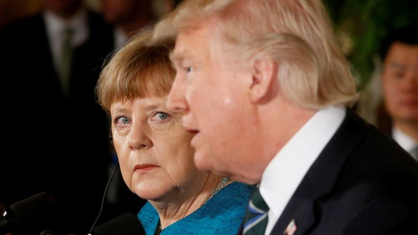 Donald Trump: Germany's Chancellor Angela Merkel and U.S. President Donald Trump hold a joint news conference in the East Room of the White House in Washington, U.S., March 17, 2017. REUTERS/Jonathan Ernst     TPX IMAGES OF THE DAY - RTX31JOP