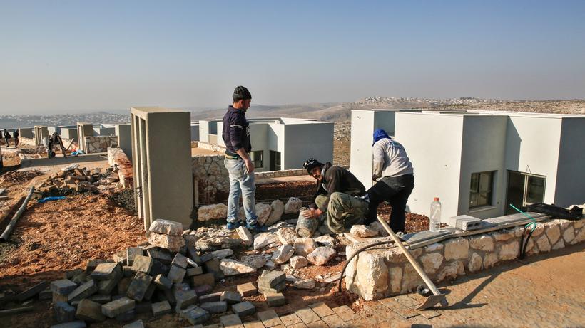 Siedlungsbau: Palästinensische Arbeiter auf einer Baustelle in der israelischen Siedlung Na'ale nahe Ramallah