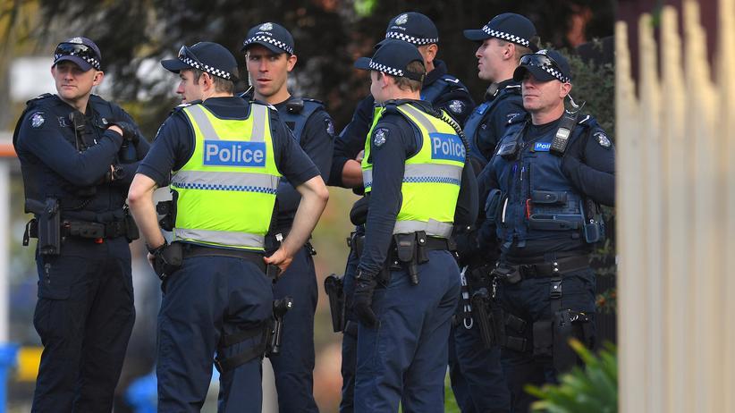 Australien: Australische Polizisten vor dem Haus, in der die Geiselnahme stattfand