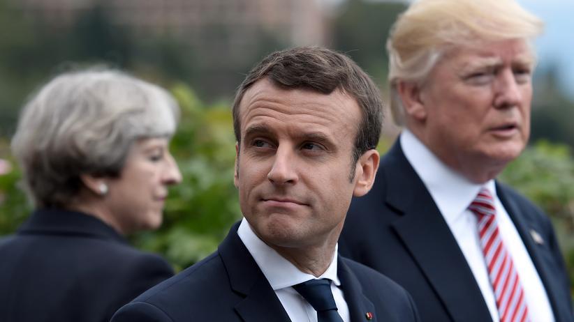 Giftgasangriff in Syrien: Großbritanniens Premierministerin Theresa May, Frankreichs Präsident Emmanuel Macron und US-Präsident Donald Trump beim G7-Gipfel in Italien (Archivbild)