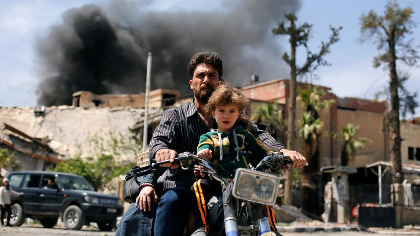 Syrien: Eine Straßenszene in Duma, das erst seit kurzem wieder vollständig unter Kontrolle des syrischen Regimes ist.