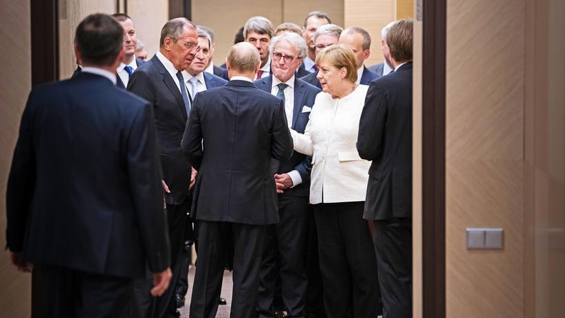 Angela Merkel und Wladimir Putin: Immer auf der Hut