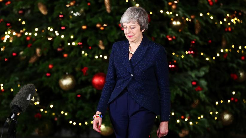 Brexit: Britain's Prime Minister Theresa May prepares to speak outside 10 Downing Street after a confidence vote by Conservative Party Members of Parliament (MPs), in London, Britain December 12, 2018.
