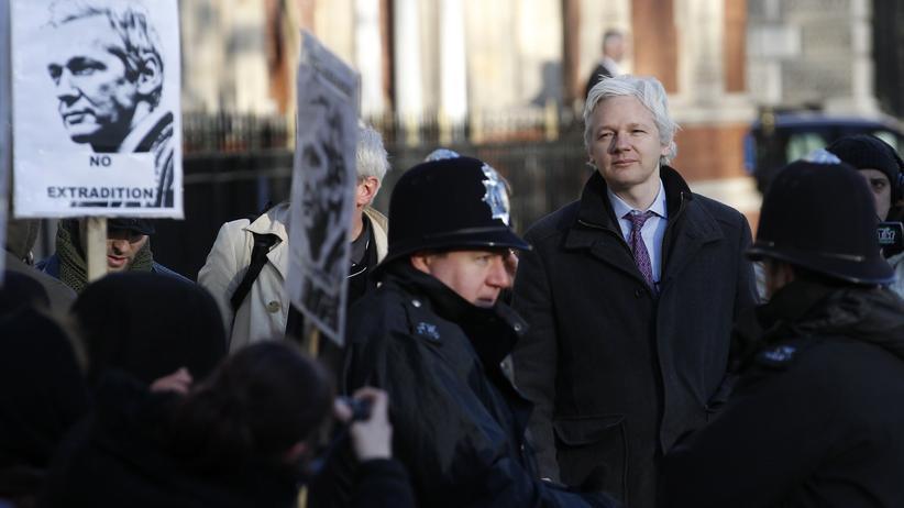 Julian Assange: WikiLeaks founder Julian Assange is seen on the balcony of the Ecuadorian Embassy in London, Britain, May 19, 2017. REUTERS/Peter Nicholls